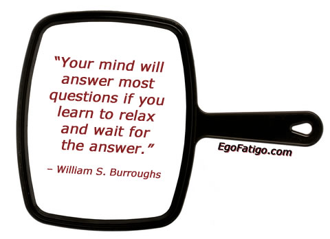 William S Burroughs quote about questions and answers on a black-framed mirror